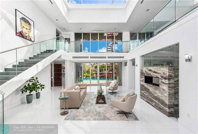 Custom designed modern luxury residence on a wide canal in the Las Olas Isles, built in 2015, dock up to a 90' yacht. Top-of-the-line chef's kitchen, gas fireplaces, elevator, integrated lighting & sound systems, pyramid skylight, impact windows, 4 energy efficient A/C's, motorized blinds, an outdoor oasis featuring a beautiful rooftop deck w/ artificial grass. Walking distance to restaurants and the beach. 6 beds - 7 baths - 2 half baths - 2 laundry rooms - office - theatre room - 3 car garage
