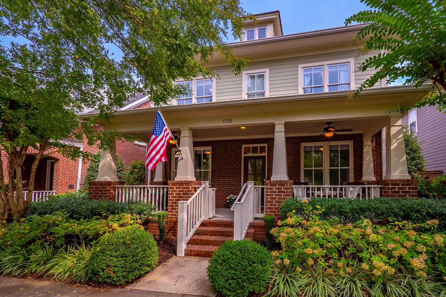 Charming craftsman style home overlooking beautiful green space! Centrally located - walk to everything! Spacious kitchen w/ Double ovens & large marble island! Completely renovated master bath! 8 ft. doors & custom closets throughout! 3BR's 2bath upstairsin main house w/ bonus room!  Massive studio (5th BR) over garage could be in-law suite, office, man cave, or extra income potential w/ a sep. entrance. Lg. year round screened in porch! Garage has a large golf cart space w/ separate entrance.