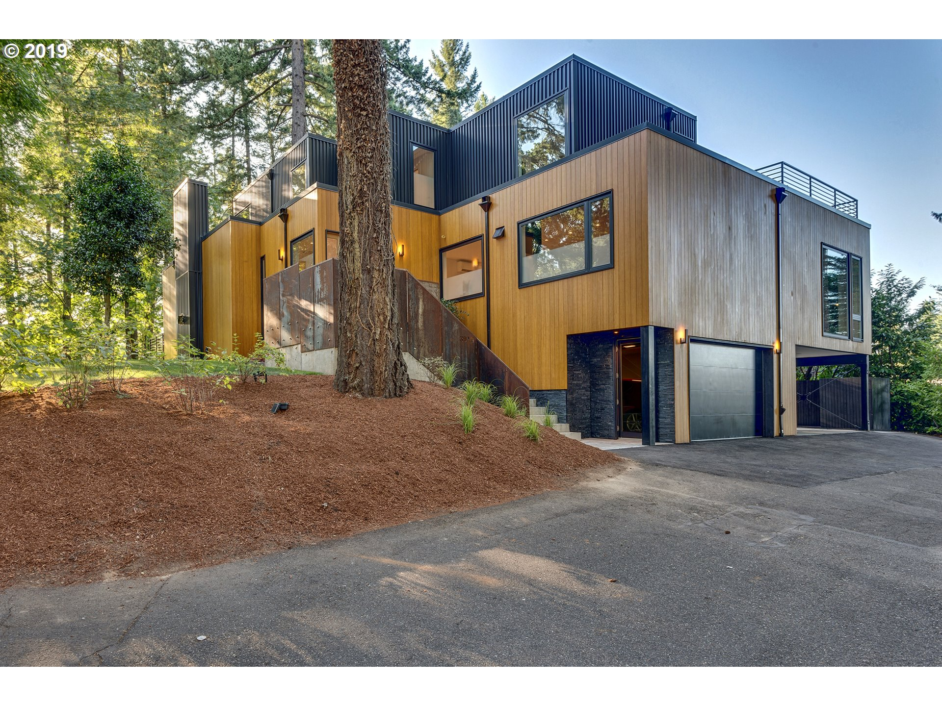 Brand new Modern Masterpiece designed & built to exacting standards by award-winning architect Walker Templeton. Located near Oswego Lake with access to 4 easements. Environmentally conscious and durable design with bamboo siding, metal accents, recycled denim insulation and gorgeous finishes.  Sleek kitchen with huge windows and 16-ft island. Open plan design - every room flooded with light. Spectacular master suite with luxurious bath