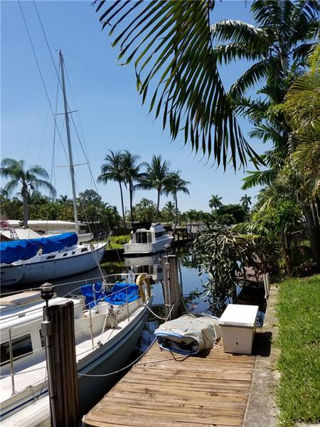 Incredible 3-bedroom/2-bathroom waterfront home in Fort Lauderdale in the Lauderdale Isles area. This house is located on Bimini Lane in a great neighborhood. The house has hurricane rated impact windows and central air-conditioning with an incredible spacious living room and Florida room with view on the canal. The backyard of the house is on a canal that joins the New River with 48 feet of waterfront with a boat dock with ocean access and no fixed bridges. There are fruit trees (avocados) in the back yard of the property. The house is a little tropical paradise hidden in an urban jungle.