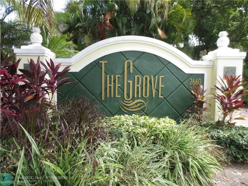 Welcome to The Grove at Wilton Manors.  This Gated Boutique Complex is located just Behind Rosies and is walking Distance to Clubs, restaurants and shoppes of Wilton Drive.  Complex offers a Heated Pool.  This Unit has been updated and does not have the original  Build out.  Which Kitchen with Granite Counters and Stainless Steel Appliances.  Tile Floors Throughout. Assigned Parking Space for one vehicle....Laundry room offers all updated Washer and Dryer units