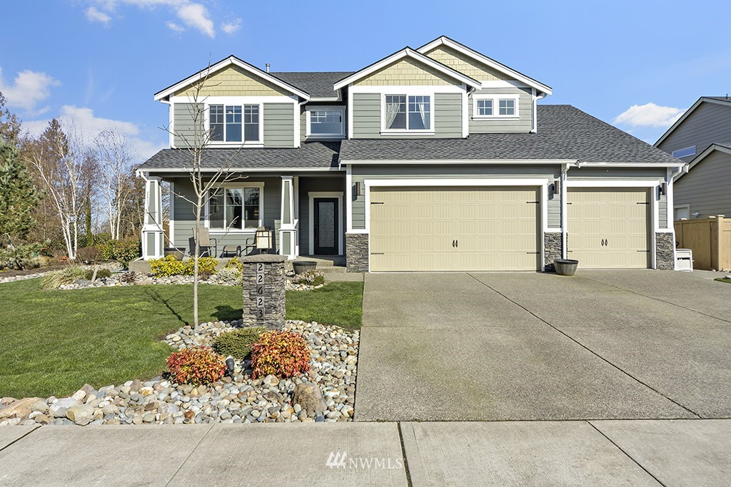 """Pristine one-owner home on culdesac in Scenic Point emanates pride/warmth thruout. Four xlg BR's, formals, bonus room, 3000+sf, enviable Mt Rainier & territorial views, 4-car att garage. New Cambria quartz counters & 36"""" undermount sink, upgraded appliances, custom master shower, custom lighting/blinds/formal area ceilings, uncommonly spacious rooms, elegant millwork, newer carpet, gorgeous hdwds, family room builtins, designer decor, abundant natural light! Custom front door, heat pump w/AC, generator switch, tongue/groove patio ceilings, wide garage doors w/belt drive openers, tankless H/W, smart home wiring, extended patio/sidewalks, full irrigation sys & landscape lighting. Copious storage! Nbrhood park/play area & White River schools."""