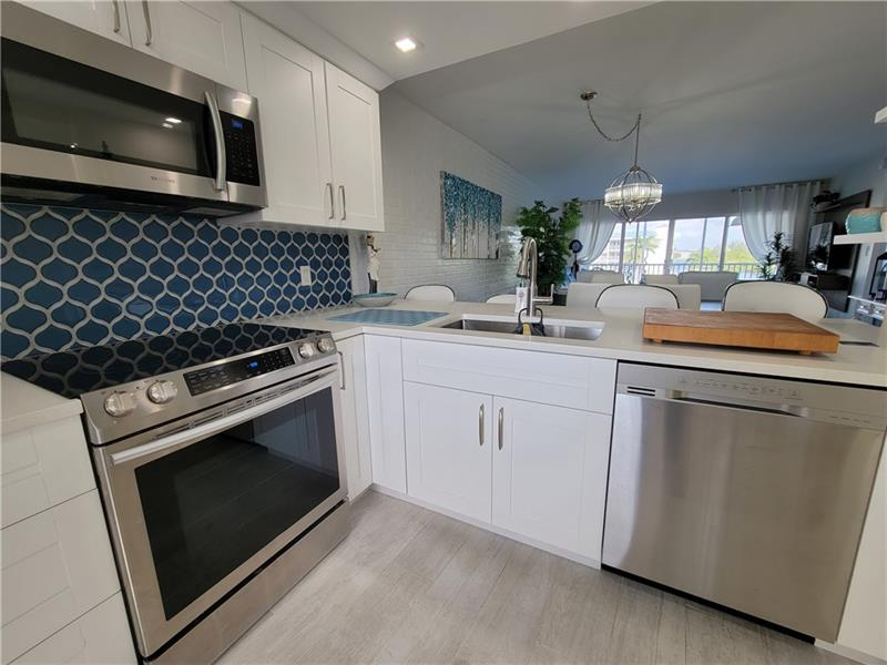 Fabulously updated high floor unit,  with views of the gulf stream canal and Deerfield island park. Unit boasts Washer dryer all new appliances , kitchen ,bathrooms etc. All windows and sliders will be replaced with impact in the next few weeks. Community has boat slips and there is a waiting list at this point.
