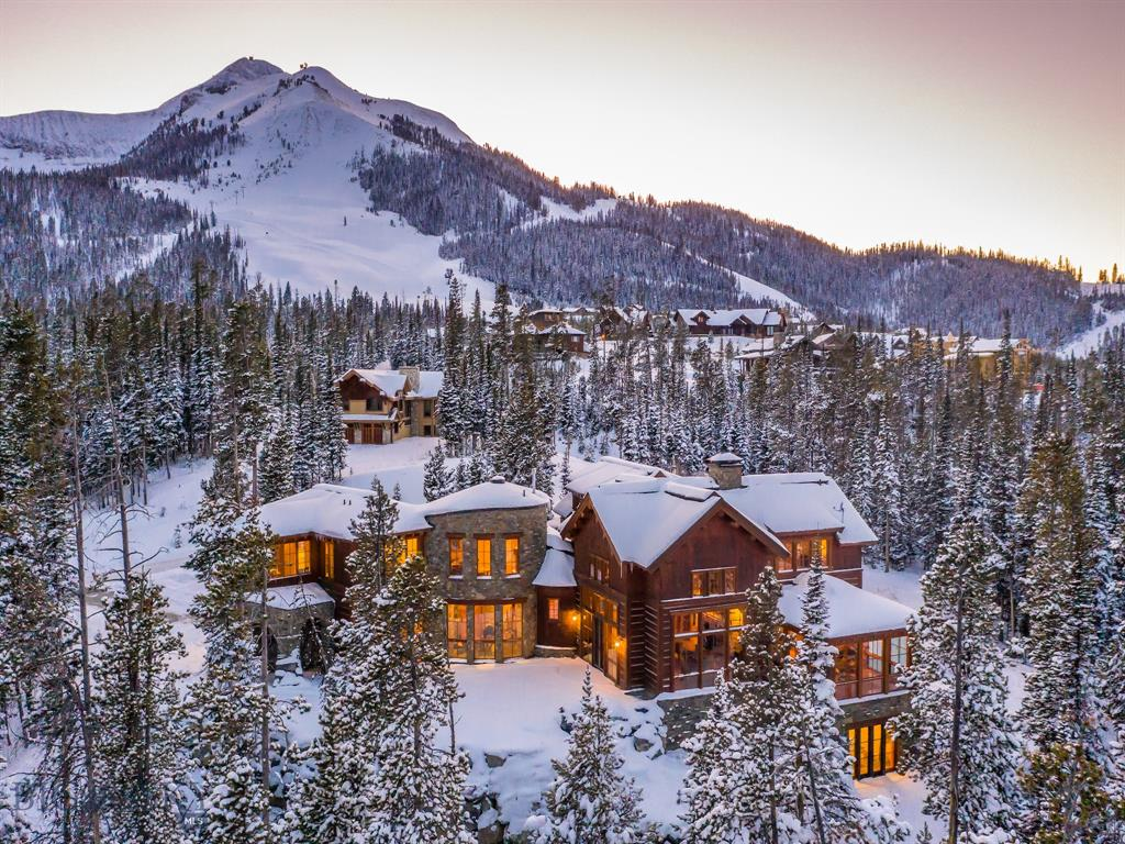 Easy Ski in Ski out to Moonlight and Big Sky Ski Resort. Designed by acclaimed architect, Weldon Turner and built by Blue Ribbon Builders, this flawless home is a masterpiece of design and construction. Native and reclaimed natural materials were used to produce timeless spaces with easy warmth and grace. Enjoy 2 private offices and a morning room with three floor to ceiling glass walls that surround you in the beauty of the landscape. The chef's kitchen is the place to gather around the fire with family and friends. It includes a  Thermadore 6 burner stove plus griddle and double oven, 2 GE full size refrigerator/freezers, tons of cabinets and storage space.  The vaulted great room ceiling is a piece of art forged of steel and huge hand hewn wood beams. This is a beautiful and very unique home.