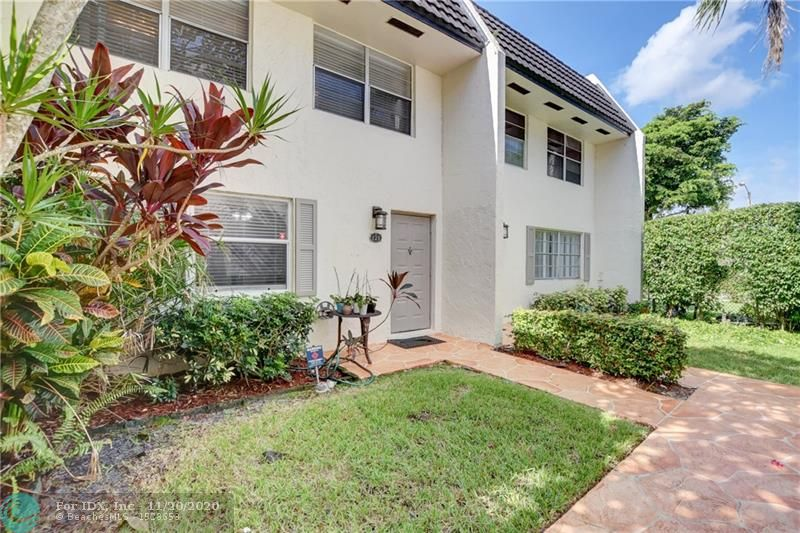 """Beautiful well maintained and tastefully updated 3/2.5 in Coral Springs!  This terrific unit boasts granite countertops, stainless steel appliances, glass backsplash, crown molding throughout, updated bathrooms, custom closets, huge master bedroom and much more.  Enjoy your lush water view from your master bedroom balcony!  Conveniently located near shops and restaurants including """"The Walk"""".  Move In Ready"""