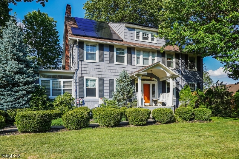 Classic center hall colonial with 6 bedrooms located on desirable street on Westfield's north side. Walkable to town & amenities. Four finished floors of living space. Abundant space & natural light throughout home. Gracious center hall entrance is flanked by expansive LR/FR on one side & banquet size DR on the other. Eat-in kitchen with large island. Finished basement offers many options with extra room for office. Second floor has 4 BR with extra sunshine filled room off of one BR. Third floor boasts 2 BR with a full bath. Many recent improvements including new cedar fence Spring '21.  Zoned for Washington Elementary, a Blue Ribbon school. Detached oversized garage AS IS. This home is a must see!!