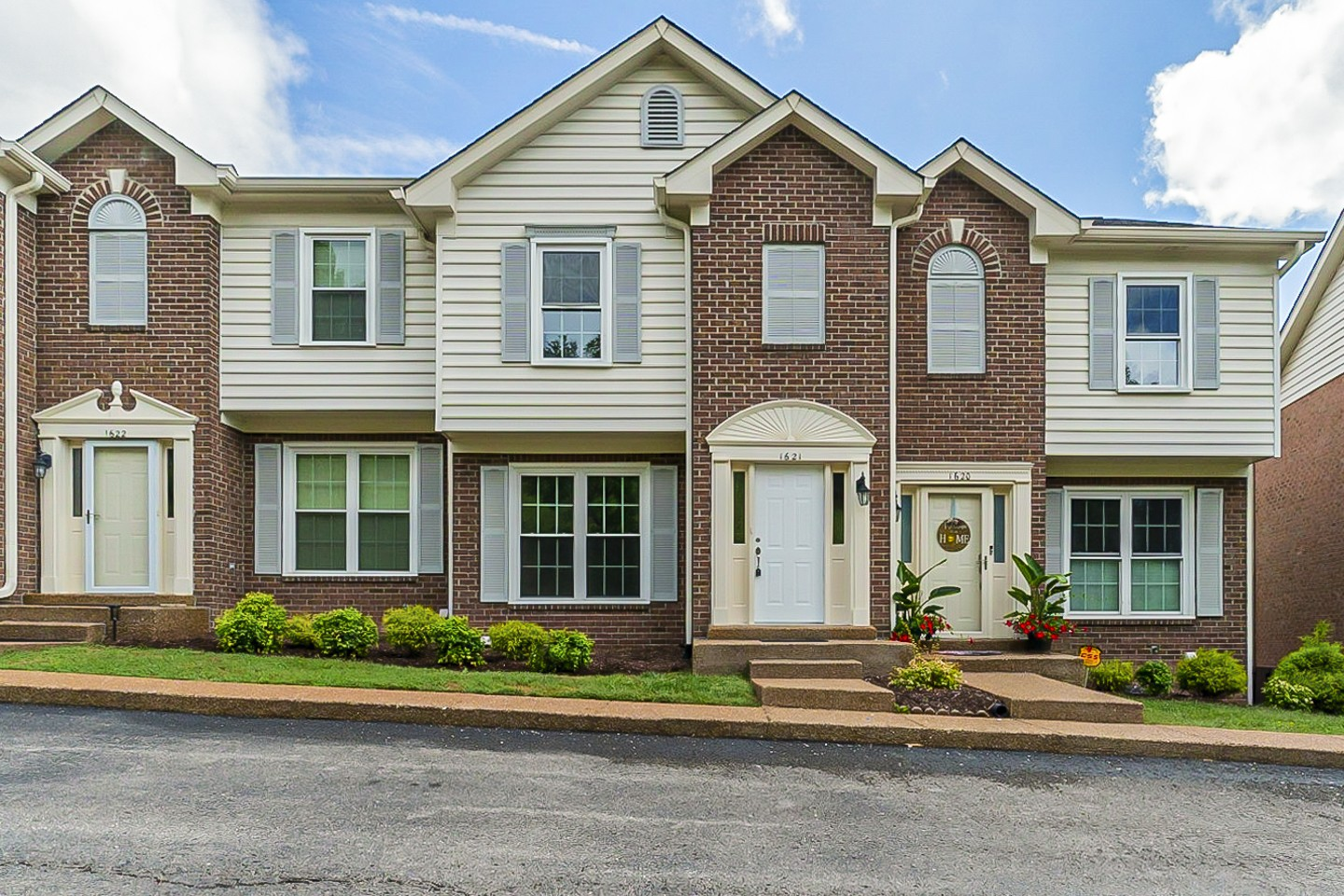 """You will love this beautiful townhome nestled in the heart of Cool Springs in """"Brentwood Pointe - The View""""! With features like caramel-colored hardwood floors, new carpet, fresh gray paint, tasteful crown molding and a large gas fireplace, this home is both sophisticated and cozy. Full basement suite with a bathroom and walkout ground floor entrance! You will absolutely LOVE the beautiful, private view of Franklin from the back deck."""