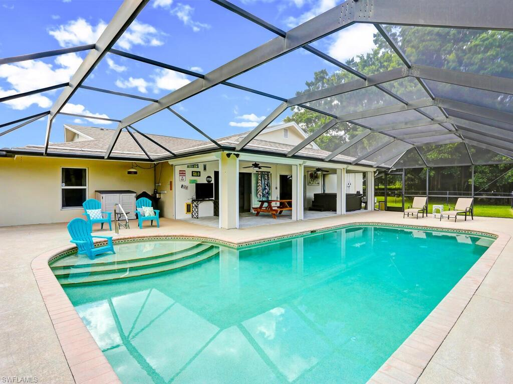 Sweet Family Retreat! Looking for the perfect spacious single family home of your dreams? 2579 Sq. Ft. of  living w/4 BR – 3 full baths (2 MBR suites). Home has new roof (2018) – impact glass windows & front door, amazing oversized solar heated pool w/sun deck, and private R & R back yard – even fenced area for your dog w/their own back access! Hurricane shutters for lanai sliders add protection. The Main MBR suite is beautiful, with huge closet, wow bathroom w/large walk in shower & double sinks. MBR has separate AC unit! The lg. laundry has double sink and lots of storage and access to double side load garage. The long paver driveway to sweet home has room for cars – and flawless curb appeal to this property. Call for showing appointment – this home won't last!