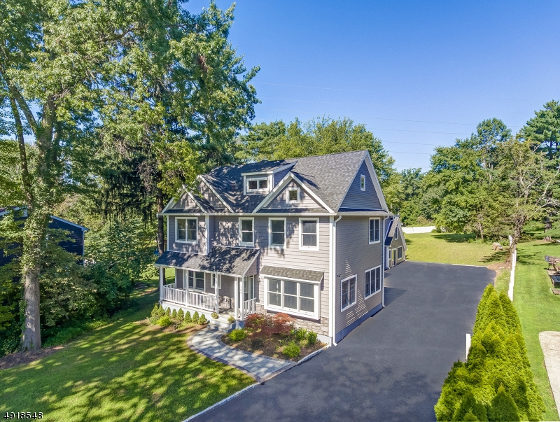 This stunning custom built Colonial rests on a half-acre of level property. A paver walkway & inviting front porch welcome you inside this home which features 5 BR's plus a 1st flr office, 3 full & 2 half baths. Quality craftsmanship, architectural details, custom millwork throughout. Bright & open floorplan w/ soaring ceilings in the great room. Gourmet kitchen with large center island, quartz countertops, Samsung appls incl. 5 burner stove & french door Family Hub Smart Refrigerator w/ WiFi &Touch Screen. The 5 bedrooms are located on the 2nd floor. The Master Bedroom offers a tray ceiling & his/hers walk-in closets. Expansive 5th bdrm can be used as inlaw suite w/en-suite bath, private staircase leading to living area, or use the versatile space as a home office. Finished basement, spacious backyard.