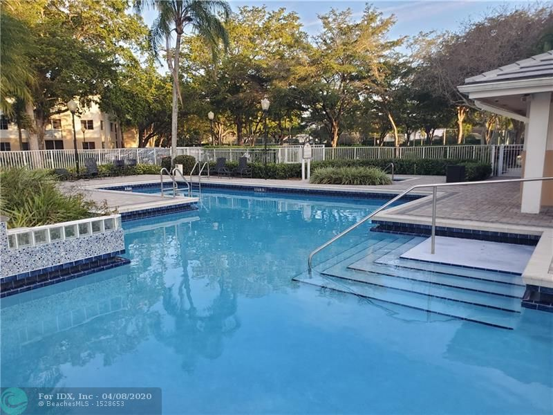 Beautiful Updated 2 bedroom 2 bath condo in Desirable Coral Springs!  Wood cabinets with Granite countertops, SS Appliances. Brilliant creamy porcelain tiles throughout, updated bathrooms, washer/dryer in the unit, tons of closet space. Perfect for you or as an investment. Neighborhood features lovely pool area, Great schools and close to shopping, movies, restaurants, highways, hospitals and more.  This condo has an assigned covered parking space and storage space in separate storage building.