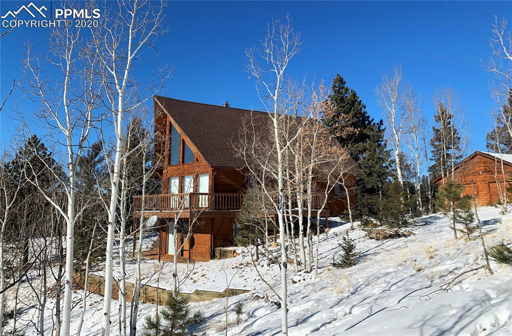 This beautiful mountain home sits on 20+ acres of private, treed land, nestled between two cul-de-sac's for maximum privacy. The home features breathtaking, endless views and large, open common areas that maximize the sights from all three levels of the home. As you enter the home you will be drawn in by the 22 foot cathedral ceilings and large south facing windows. The homes passive solar and high efficiency wood stove help keep your utility bill low.