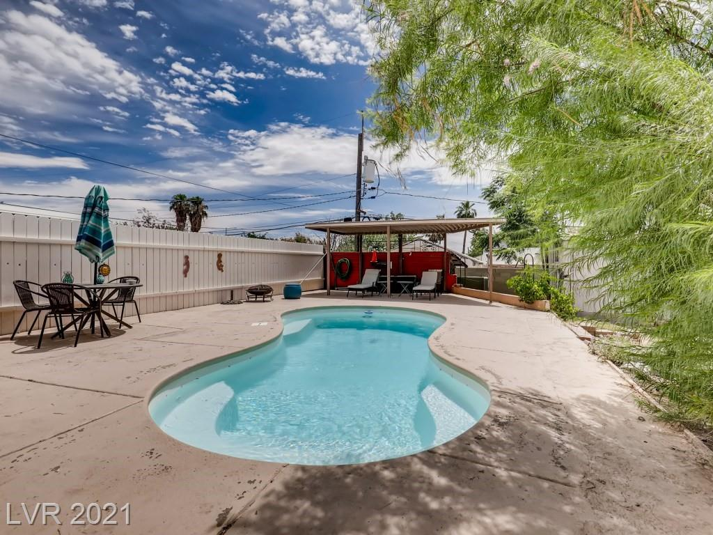 This charming single story home with Pool has been remodeled/updated and ready for you to call home! With only a short walk to the restaurants, bars and casinos of Down Town Las Vegas, you won't find a better value property than this! The kitchen features white shaker cabinets, huge butcher block wrap-around Island with farmhouse sink that overlooks your huge backyard with sparkling pool. The two bathroom showers have also been updated and finished with a sleek subway style tile. Being situated on almost a quarter of an acre, the only limit to what you can do is your imagination. The seller has replaced many of the windows with high quality Andersen Windows and there is NO carpet at all. This home won't last long! Schedule a tour today!