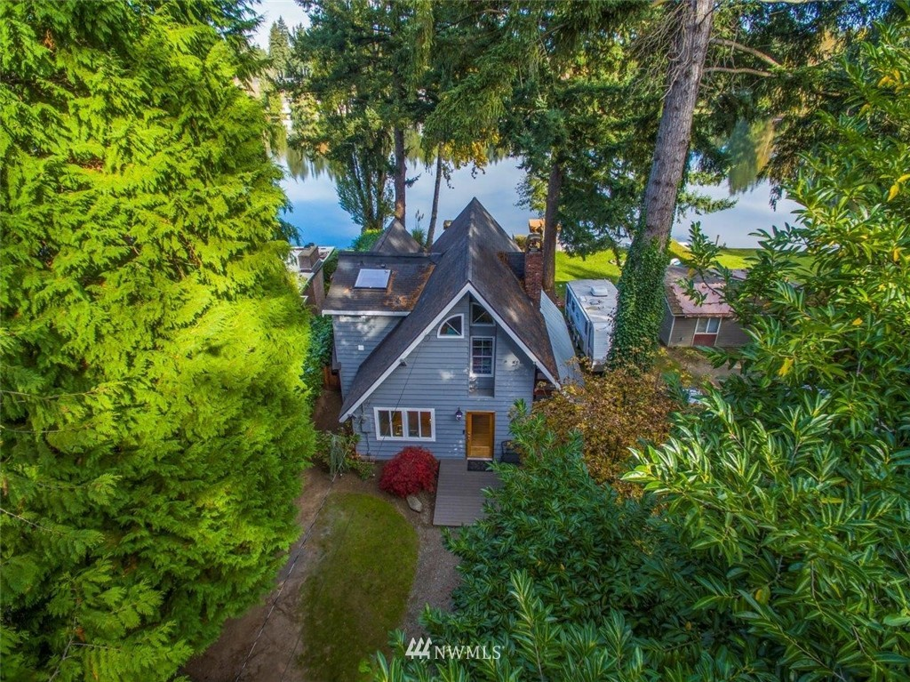 Enchanting waterfront home on peaceful Mirror Lake in the middle of Federal Way and 10 minutes to the new light rail! Main living area has impressive stone work, gas fireplace plus an eating bar for eight and an upgraded kitchen with room for all. The powder room is slate tile with a vessel sink. Views are glorious from every window! New custom decking embracing the covered and uncovered outdoor space. Deck rail has cable links so view is not obstructed. Open coved ceilings on the upper level.