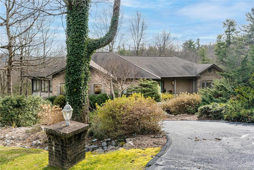 Fantastic Value in Prestigious Kenmure! Priced below Tax Value. This lovely home is situated on 2.05 private acres with partially fenced yard. The main level boasts an open plan, great room with gas fireplace and built-ins, expansive chef's delight kitchen with abundance of counter space and cabinets with pull-outs, eat-in breakfast table, double ovens and cooktop, dining room with tray ceiling and large windows, large study/bonus room, beautiful sunroom to enjoy the private natural setting, master suite with tray ceiling, His and Her walk-in closets, double vanity with make-up area, jet tub and walk-in shower, guest bedroom with ensuite bath, powder bath and laundry room with cabinetry and sink. The lower level features a chair lift, third guest bedroom with ensuite bath, great bonus/hobby room and mudroom area. There is a huge workshop and storage space along with a garage that can easily hold 3 plus cars. Pet Friendly yard. Generator and radon system. Convenient to gate & amenities.