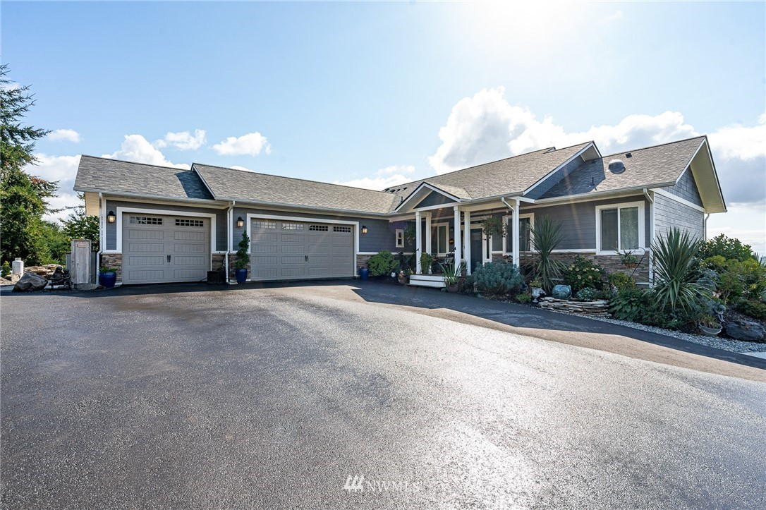 Come see this beautiful 2018 home on 1.7 acres on the Northeast hillside of Centralia. Home features four bedrooms, three bathrooms, one bonus room, a media room and, one office/den space. Home comes with a kitchen on both the main and lower floors. Lower level could be used as a separate apartment, complete with external access. Home wiring for the possibility of a generator, indoor/outdoor fire place between the great room and the back deck. In addition to beautiful views, property features fruit trees, stone work, 10x20 shed with RV hookup (septic also has an RV clean out), a cleared and compacted area for a 30x36 shop. Shop design and building permits have been approved. Bring your clients, friends, and relatives and take a look.