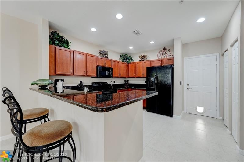 Amazing opportunity to own a NEW 2013 3/2.5 townhouse in the sought after gated community of Paloma Lakes. This 2-story unit features: hurricane shutters, 2 car garage, updated kitchen w/wood cabinets & granite, laundry room w/full size washer & dryer, open floor plan, recessed lighting, tile floors throughout first floor, carpet on second, spacious master suite w/tray ceiling, (2) large walk-in closets & balcony and master bath boasts dual sinks, separate tub & shower. Community Pool just steps away. Maintenance fee includes internet & basic cable, roof, building exterior & common areas. A short distance to the upscale Promenade with outdoor dining, shopping & theater. Close to Sawgrass & Turnpike. Pet friendly (2 pets 70 lbs total). Assn. requires 650 credit score. See attachments.