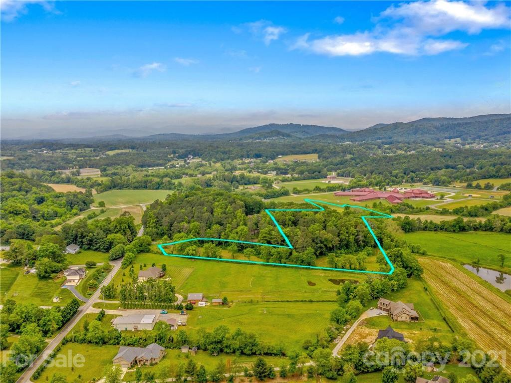BREATHTAKING CANE CREEK VALLEY! Build your Mountain dream on this nearly 9 acre Prime Lot! Bring your horses, dogs, fishing rod and experience heaven! Imagine cool Blue Ridge Mountain evenings rocking on your front porch serenaded by your own private creek or two! Along with a small creek branch, majestic Cane Creek- stocked annually with fresh Mountain trout, meanders through this special property! Enjoy nice deep fishing and swimming holes, lots of pasture and gently sloping land offer room for large garden, views and level land for barn! There is a parking pad and driveway cut in and ready for easy view. Includes new 4 bdrm Septic Permit, new survey with topography. Mins to Ashevlle, Airport, Chimney Rock, Lake Lure! Enjoy local favorites, Hickory Nut Gap Farm, Trout Lily Market, Whistle Hop Brewery, Great music and local Food at The Joint Next Door and Local Joint! This majestic property makes it easy to live the Smokey Mountain Dream!!