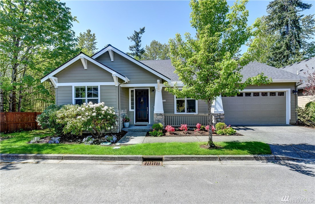 On a private lot overlooking greenspace is this stunning Maple plan home. Recently remodeled w/contemporary finishes & upgraded systems, this home is like new construction. 3 bdrm, 2,505 asf rambler lets you downsize without compromise. $75,000+ in upgrades since 2018: Trane furnace & roof, house lighting sys, W/D, DW & stove vent, master bath + CA closet, den built-ins, guest bath, laundry, epoxy garage flr+finished walls+rack sys, tankless on-demand water heater. Age restriction, 53 years+