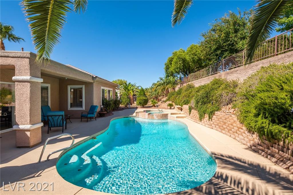 Welcome to this sought-after Cambridge model on a premium corner lot with pool and spa in the Valleyview Village of the 55+ Sun City Anthem age restricted community. You will fall in love with the gorgeous curb appeal composed of pleasing landscapes and gated courtyard with peaceful fountain. Open concept living space features a ceiling fan, surround sound, custom built-in entertainment system, cozy fireplace, and beautiful glass doors leading to custom den spaces with built-ins. Kitchen treated to top quality cabinetry, corian counters, breakfast bar, and convenient island. High-end appliance package consists of Sub-Zero refrigerator, Fisher Paykel 2 drawer dishwasher, Trivection oven, 5 burner cook-top, and a wine refrigerator. Peaceful backyard is highlighted by a sparkling pool, relaxing spa, outdoor kitchen, covered patio, and a sense of privacy. Upgrades and extras include remodeled bathrooms, new water heater, recirculating hot water, new AC, and new quartz plaster pool and spa.