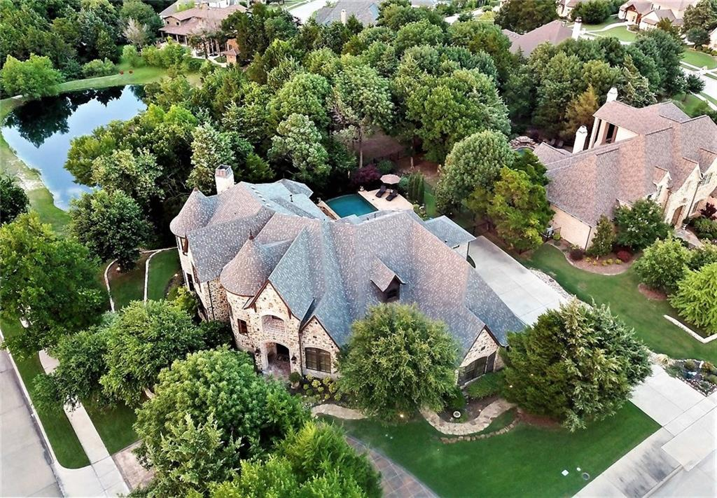 This time this really is  A MUST SEE, ONE OF A KIND LUXURY HOME AND THIS TIME THIS REALLY IS IN ONE OF HEATH'S MOST DESIRED AND ARGUABLY THE MOST BEAUTIFUL NEIGHBORHOOD IN ALL ROCKWALL COUNTY.  Just over 5000 ft of unmatched luxury living on a corner surrounded by the most beautiful heavily treed land you're likely to see, anywhere.  Flanked by a quaint pond, pool + spa complete with panoramic views of what you will not find with any home currently for sale under a Million Dollars. And because the seller just happens to be a true Custom Luxury Home builder who's the areas most spectacular homes, most personal changes can be easily made. Do yourself a favor, save this one for last!
