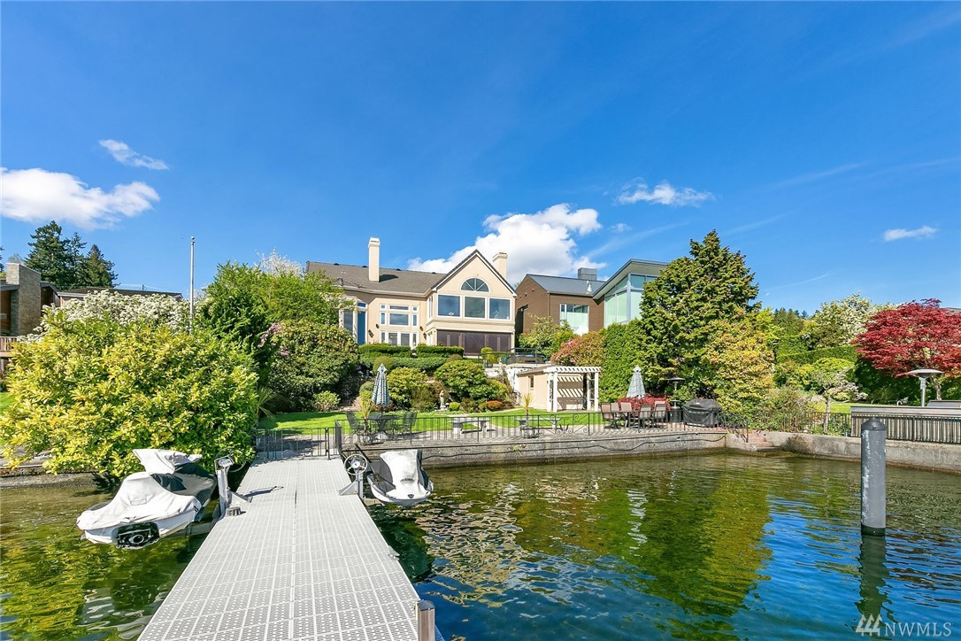 Elegant traditional home with fantastic Lake Washington waterfront! Gorgeous entertaining spaces w/soaring ceilings, full of natural light & stunning views. Enjoy the beautiful dining room, expansive living room, spacious kitchen open to family room, master suite, two guest suites & media room w/built-ins & wet bar! Lush landscaping, ideal waterfront entertaining spaces & large dock w/lifts! 2-car garage, ample storage, a/c & more! Unparalleled lake, city & mountain views from nearly every room!