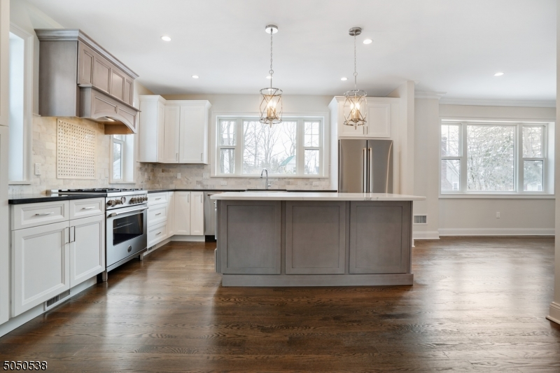Unmatched NEW CONSTRUCTION with a thoughtful layout and intimate details throughout. Tucked away in a coveted neighborhood of Berkeley Heights resting on .29 acres. TOP Schools w/ easy commute. TWO story foyer oozing abundant sunlight welcomes you with confidence. Continue on to find a coat closet, garage entrance, full bath, enclosed den/office, dining area opens to a custom kitchen w/ stainless appliances & a sizable family rm that opens to a private patio overlook a deep/lush level yard. The 2nd floor is home to FOUR generous bedrooms, the primary suite equipped w/ a walk in closet, stunning bath w/ stall shower & soaking tub, 3 additional bedrooms share a lovely hall bath & laundry rm complete this level. The basement is an open canvas to finish to your taste, all plumbing & electric are in place.