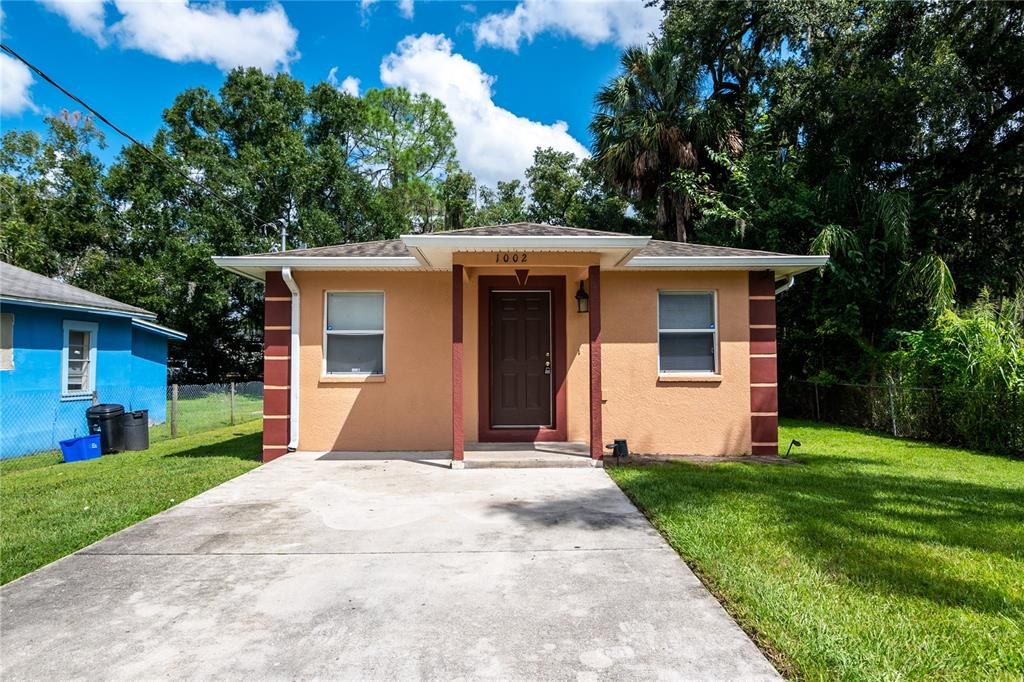 Concrete block 3 bedrooms, 2 baths, 1,355 sf bungalow, built 2006, located in the growing downtown Plant City's Madison Park neighborhood. 2 car parking pad, 50 x 125 lot. Front and side door entrance to a family room, dining nook, and chef's kitchen complete with solid wood cabinets & L-shaped bar with room for 4 bar stools. 12 x 12 ceramic tiles flow throughout the entire home (NO CARPET). Large owners suite with ceramic tile shower and real wood vanity. Ample sized 2nd and 3rd bedrooms. Interior storage/laundry room. FHA Financing available, No HOA or CDD, 5 Minutes from I-4 for easy access to Orlando or Tampa.