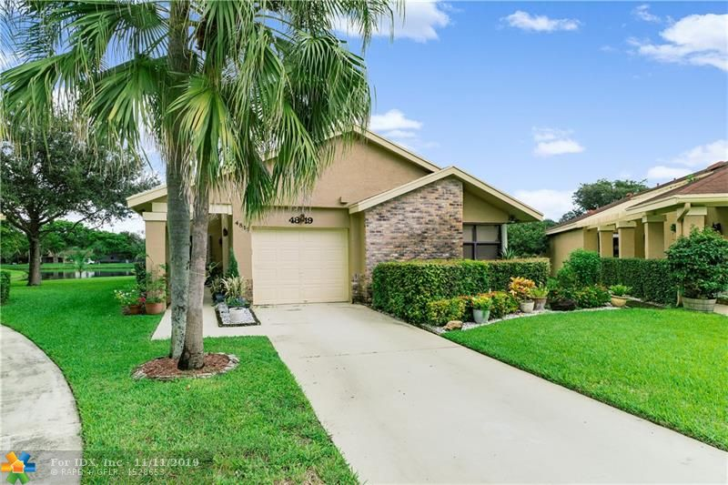 Don't miss out on this exceptional  3 bedrooms with 2 full bath home with lake view in sought after Township section of Coconut Creek. 3rd bedroom being used as office/den. Situated on a cul de sac this home has an updated eat in kitchen with granite counters and newer appliances, tile throughout with carpet in bedrooms. Glass enclosed Florida room lets you enjoy the tranquil lake view. Home has accordian shutters throughout and vaulted ceilings. A/C 2012.