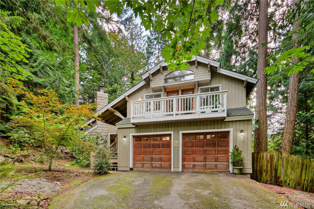 Come see this Tranquil Treehouse of a home! Inviting from the street with it's tree lined driveway & on a private third acre of PNW living. Home has been elegantly updated with a dream kitchen, walk in pantry, cool palette, & wide plank flooring. Some unique features include the loft off the master suite as well as the adjoining loft/play space over the other two bedrooms, multiple balconies & patio spaces, new water filtration, tankless water, & EV charge ready! Private but close to everything!