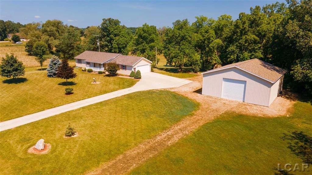 Looking for peaceful, quiet country living? This welcoming one-owner home, built in 2000, sporting 30 + ACRES, awaits you!  There are 3 bedrooms and 1.5 baths, with a 28 x 30 attached garage, 40 x 48 Pole Barn (with concrete and electric), concrete driveway, porch, and a beautiful view of your pond from the large back deck.  Centrally located between Adrian and Tecumseh, arriving home will feel like an oasis where you can row, kayak, hunt, and play. Home will feel like a vacation every day!
