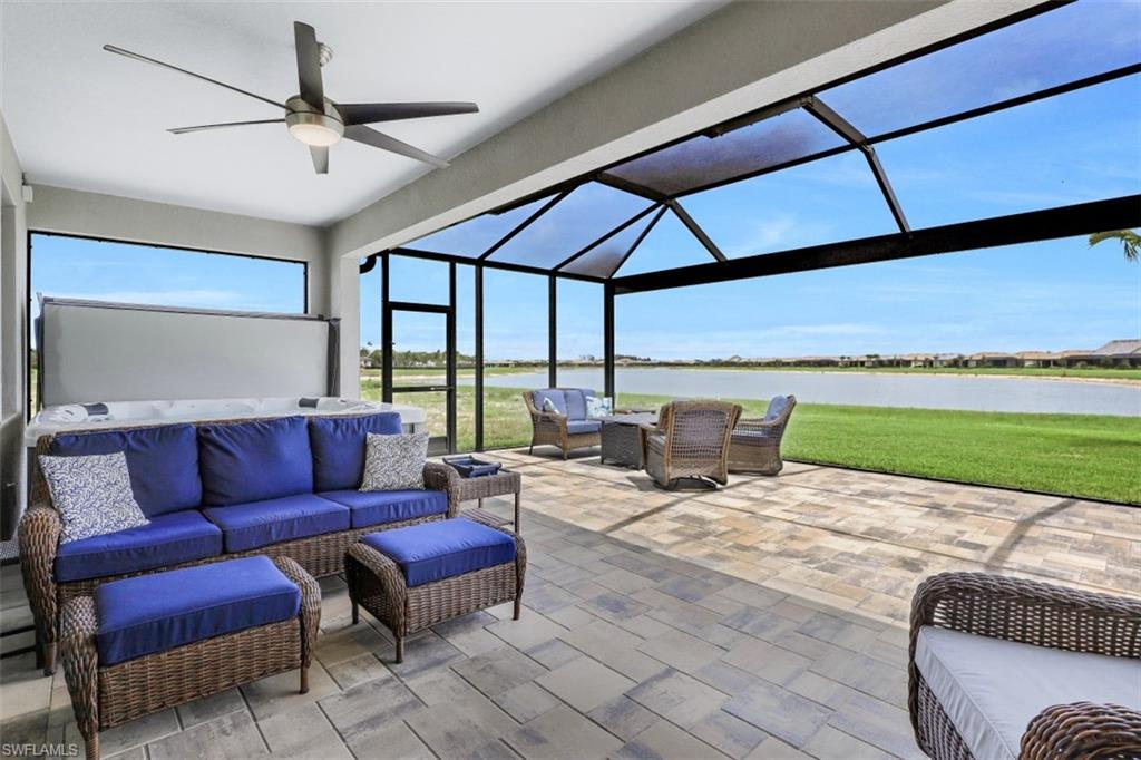 """RARELY AVAILABLE MARSALA FLOORPLAN WITH SPECTACULAR WATER VIEWS IN THE PLACE AT CORKSCREW... LOCATED JUST 7 HOMESITES FROM THE AMENITIES! This recently built residence offers 3 Bedrooms + Den, 3 Full Baths, 2 Car Garage, 2202sf living area. Relax on the Extended 16' x 40' Super Screen Pavered Lanai and enjoy the extra long water vistas, or unwind in the 8' MasterSpa Hot Tub while listening to music or watching TV. Builder Features/Options include: 21"""" Porcelain Tile, White Cabinetry, Crown Molding, Granite in Guest Baths. In addition to the Outdoor Enhancements, other post-closing improvements include: Screened Front Entry, Quartzite Counters/LED Under Cabinet Lighting/Backsplash in Kitchen, LED Recessed Lights in each room, Frameless Heavy Glass Shower Enclosure, Barn Doors in Den, Custom Closets, Garage Door/Attic Insulation and Storage Racks, Ring Security System. Amenities at The Place are second to none!: Resort Pool w/100' Waterslide and Spa, Indoor Restaurant, Bourbon Bar, Cafe, Outdoor Bar, Fitness Center, Movement Studio, Tennis, Pickleball, Bocce, Basketball, Playground, Dog Park, Childwatch, Spa Services, (2) Manned Guard Gates. Fences Allowed! NEW PUBLIX COMING SOON!"""