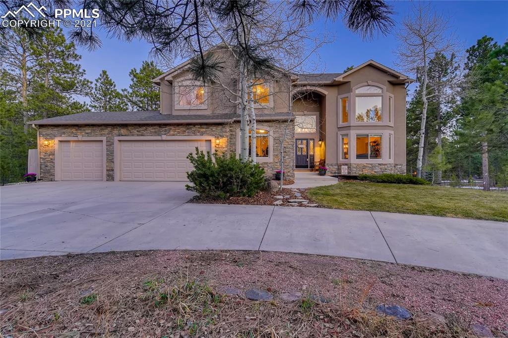 Gorgeous, custom two-story nestled at the end of a cul-de-sac on 2.5 acres, surrounded by mature Ponderosa pines in the desirable and exclusive community of Bent Tree. The long, circular driveway creates additional privacy on this premium lot, while the covered entry warmly welcomes you into the home. Once inside, the beautiful, new wrought iron staircase and recently resurfaced and stained stunning hardwood floors capture your eyes instantly! Open formal dining and living room areas and main level office with French doors greet you near the front of the home. The great room boasts large expansive windows to take in the fantastic forest views and showcases a floor-to-ceiling stacked stone fireplace accent wall. Large composite back deck off the kitchen with upgraded iron railings, to accentuate the scenery, and a spiral staircase to the lower level. The well-appointed kitchen has high-end cabinetry with crown molding, quartz & granite counters, a large island with elevated bar top seating, a kitchen eating nook, pantry, gas cook-top, newer stainless steel appliances, & skylights. Large, main-level master suite with a walk-out to the composite deck, roomy walk-in closet, and spacious five-piece bath. Spacious main level laundry room with additional storage, sink, & a secondary walk-in pantry. Upstairs you'll find a spacious and open loft area, two bedrooms, and a full bath. Finished walk-out basement with 2 bedrooms, full bath, three-sided gas fireplace, & the expansive family room complete with wet bar/kitchenette. Large lower back patio from the walk-out slider. Additional unfinished storage area large enough for an additional bedroom if needed. New A/C unit. Attic fan. The home has been exceptionally maintained and upgraded with a very functional floor plan! Low maintenance stucco and updated stone exterior. High-Speed gigabit internet to the home. Close to the amenities of Northgate and Monument w/quick access to I-25 and HWY 83. Award-winning School District 38.