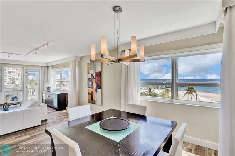 """*Walk thru tour VIA the virtual tour link* The moment you enter this gorgeous unit,you see the ocean!This is the only beach front, corner unit for sale in the """"10 stack"""". Direct unobstructed views of the ocean. Large open floor plan boasting wood porcelain tile throughout. Originally a 3 bedroom,opened up for more living space,can easily be converted back. Open gourmet kitchen offering recessed lighting,marble counter tops, back splash, stainless steel appliances & pantry.Gorgeous updated baths. BONUS room as an office/den or accommodate a single bed. Impact windows. Pet allowed under 15 pds.Guard in lobby. 24 hour front desk.Complimentary laundry. Gym. Ask your agent about the multi million dollar transformation of the pier/restaurants under construction!"""
