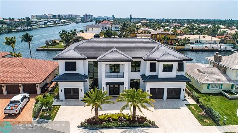 """New Construction masterpiece one lot off ICW w/ Southern Intracoastal views and 90 feet on the Kingfisher canal. Must see to appreciate the many high end features of this remarkable home. 5 BR w/ in suite baths + half bath & exterior full cabana bath.  Gourmet kitchen w/ high end Wolf/Subzero appliances & fine modern Italian cabinetry. 48"""" square porcelain tile thru out liv areas  3 car garage designed for lifts* Elevator ready* Natural gas to stove*Navina recirculating water heaters*pool heater*summer kitchen.  A gas line is plumbed to add a generator. The awesome backyard has shell stone surrounding the 40x15 saltwater heated pool w/ an amazing floating spa in the sun shelf $ water steps. The shell stone also covers the 80 foot concrete dock that has two lower boarding levels & boat lift"""