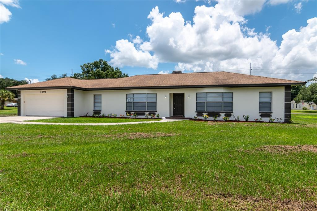 *** Seller Will Pay $5,000.00 In Buyers Closing cost***Turn-Key move-in ready 3 bedrooms, 2 baths, oversized 2 car garage, 1,678 sf, block home located in growing Downtown Plant City. This amazing home isn't on the normal cookie-cutter city lot. This .33 acres lot (139 x 105) has a Dimensional Shingle Roof installed in 2016, offering lower homeowners insurance with wind mitigation credits. As soon as you enter the front door your eyes will be drawn to the Beautiful Chef's kitchen, featuring custom-crafted real wood cabinets, Cashmere White granite countertops with a polished beveled edge, clean steel GE (smudge proof) appliance package & L shaped breakfast bar. Large family room and formal dining area. Family-friendly split floor plan with ample sized 2nd and 3rd bedrooms that share a bath with an oak vanity. The master retreat is extraordinarily HUGE (15 x 18). Master bath with white oak DOUBLE vanity & Cashmere White granite countertops. Real wood burning stone fire place.  Freshly painted interior (Kilim Beige) and exterior. Interior laundry room, brand new carpets, new Vinyl floors, new toilets & new LED lights in the kitchen. The owners just had the AC cleaned and serviced.  No CDD or HOA, 5 Minutes from I-4 for easy access to dining and shopping.