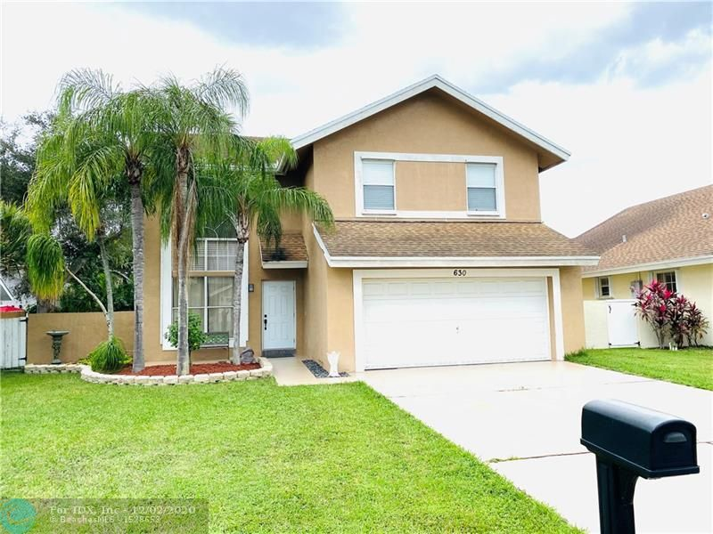 BEAUTIFUL home located in the heart of Pembroke Pines. This home has shutters throughout and also has some impact doors including the French doors in the back, the Front door and the Garage door. The Master bedroom has brand new flooring that was just installed and a large walk-in closet. Also, this home has an updated guest bathroom in the hallway. GREAT SCHOOLS! Hurry, this one won't last!