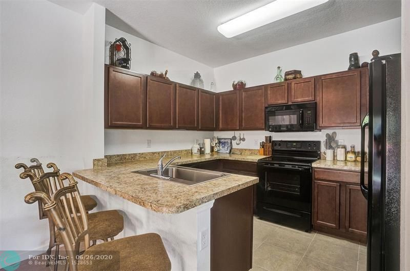 Beautifully appointed and Large TH in the heart of Ft. Lauderdale. This newer home features a new complex with all the amenities you desire to live and enjoy. Home is nestled on a Corner lot with Private Courtyard, no neighbors around, tiled floors on 1st floor, with well-kept carpet on 2nd floor, Large and Open living room, Large Kitchen with updated cabinets and Granite mica Countertops, just off a Large Dinner room or Family room, it's your choice. Very spacious home as you walk thru-out, note the feel of plenty of space, Large master with Private Patio and a Split plan, with updated bathrooms and MORE. Call or Text NOW to view and Contract today!
