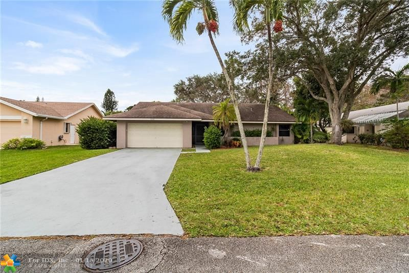 Come see this light and bright 3 bedroom, 2 bathroom home with a 2 car garage located on a lot with a peaceful water view. Laminate and tile floors in common rooms. Updated bathrooms. Oversized screened in porch. Large lot, over 10,000 square feet. Low HOA fee.