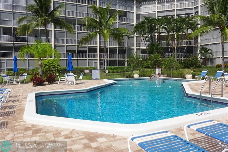 FABULOUS WATER VIEWS FROM THIS 4TH FLOOR UNIT THE MOMENT YOU WALK IN..LARGE BALCONY OVERLOOKS SPARKLING POOL, MARINA, INTERSECTING CANALS AND MANSIONS OF ROYAL PALM...UPDATED & SPACIOUS 2 BEDROOM 2 BATH WITH TILE FLOORS..