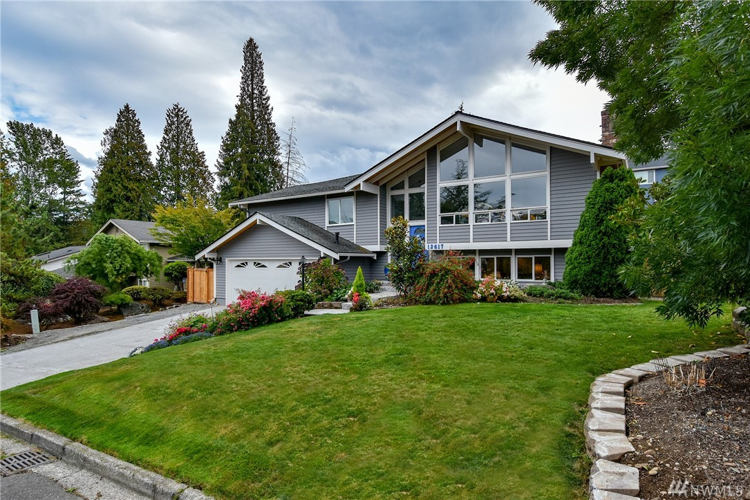 Total remodel w/1000+SF added in this gorgeous home on quiet cul de sac in Newport Woods just minutes to amenities and freeways.Open floor plan w/Hickory hardwoods, Gourmet kitchen w/slab granite, soft close cabinets, 6 burner Viking, walk in pantry...opens onto amazing deck w/vista of designer gardens on almost 10K lot. Dream Master the size of small homes: W/D, walk in closet, heated floors, soaking tub. Light filled lower w/full kitchen, 3bd, Office, full W/D..MIL/Income producer? 2+ car gar.