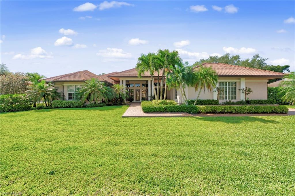 Fabulous fiddlesticks!Pride of ownership is evident throughout this large and lovely 4 bedroom plus den 4 1/2 bathroom whole home on spectacular golf course lot with views over the 14th hole in the long mean… The home was built with high ceilings, spacious rooms & an open, flowing floorplan… Lots of glass springs in the natural light and enhances the views throughout the home. Kitchen has a full wall of quality cabinets, granite, marble backsplash, open to family room, two bedroom two bath guest wing, dramatic entry with Florida ceiling views in the living room, kitchen and master suite which opens onto the lanai and features separate outdoor living spaces, beautiful renovated master bath with separate tub and shower, beautiful cabinetry lots of storage. Huge walk-in closet, beautiful home office with wood flooring and buildings, second spacious family room could be fifth bedroom with its own private lanai. Your guests will love the privacy. Call tour living at its finest with the built-in stone grill, pool deck with spectacular views and no cart path in sight. Live the Florida lifestyle to the fullest here at fiddlesticks with all of the amenities. The special home will not last.