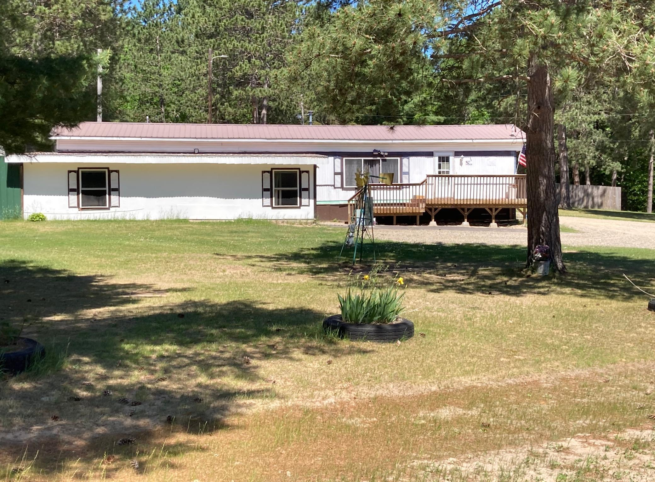 This 1975 Rosewood manufactured house offers a bonus room add on for more living area, along with additional driveway parking and private location.