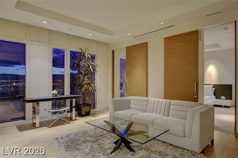 OWNER CARRY AVAILABLE!!  WALDORF ASTORIA PRIME HIGH 38TH FLR ONE BED CHI PLAN B RESIDENCE. BREATHTAKING VIEWS OF CITY LIGHTS & NEW RAIDERS STADIUM!!!  OPEN FLOOR PLAN w/ HARDWOOD FLOORING, EUROPEAN CABINETRY, & AUTOMATIC SHADES. LIVE IN THE MOST HIGH END BUILDING IN VEGAS FEATURING WORLD CLASS SERVICE & UNPARALLELED AMENITIES INCLUDING FIVE STAR ONSITE DINING & WORLD RENOWNED SPA, CONCIERGE SERVICE, PRIVATE RESIDENCE LOBBY & VALET.  PHOTOS ARE OF MODEL MATCH UNIT.