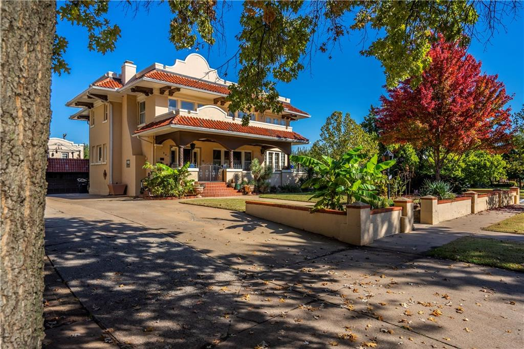 Beautiful Spanish Colonial revival style. Wonderful interior decor, very open living with three living areas, even a Man Cave. Master bedroom has large separate study and master bath with whirlpool tub and shower. Gorgeous 30'x20'x12' deep pool and covered Pergola. Lush plantings and finished guesthouse with balcony overlooking pool. Separate full bath for the pool.