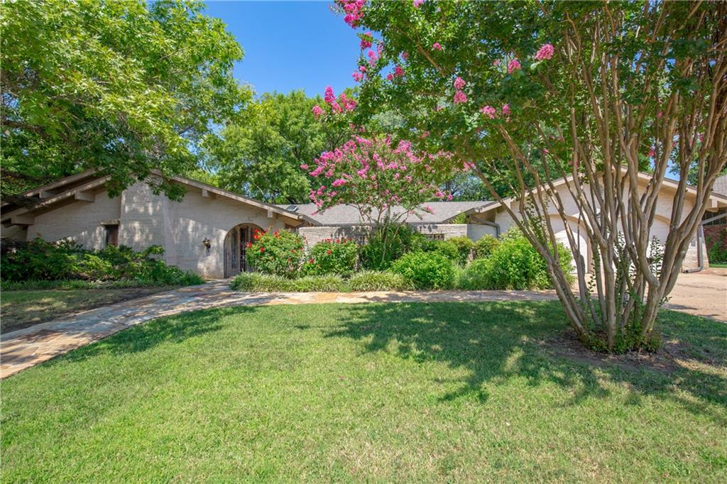 Wowzer!  This Mediterranean/Santa Fe styled home is super unique and amazing!  Come sit in the front courtyard and enjoy a cup of coffee, or in the back and enjoy the creek, birds and trees!  Conveniently located close to OU (.5 mile) and Norman's Art Walk (1 mile), this home has the most amazing custom features, including doors, built-in's and wainscoting!  Enjoy the open floor plan with vaulted ceilings, beautiful new wood flooring, plus 2 fireplaces, just to name a few!!  You would not believe the Master Suite and it's ENORMOUS Dressing Room!  The Master Suite opens up to the courtyard, has ample closet space, a fireplace, and separate tub and shower.  Both additional bedrooms feel like Masters, they are HUGE and have 2 closets PER ROOM.  No where in Norman will you find a house like this!  This amazing home has been very well cared for and has a newer central vacuum, sprinkler system, HVAC (2009), hot water tank, flagstone walk ways, and so much more.  Come take a tour today!