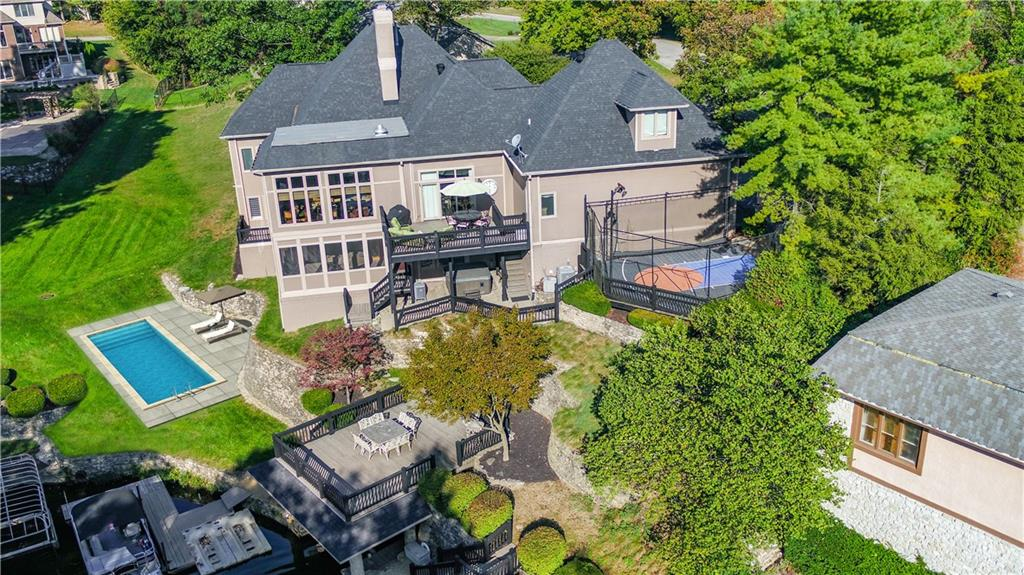 There's No Place Like Home! Magnificent Geist Lakefront Home on a Tranquil, Deep Cove, w/Exceptional Lake Views the Moment You Step Inside! Multiple Updates! Situated on .60 AC on a Private Cul-De-Sac, This Home Boasts over 6100 SF w/a Main Lvl Mstr w/Private Deck & Sizeable En-Suite w/Steam Shwr, Executive Office, Chef's Kitchen, 4-Season Sun RM w/Commercial Grill & Picturesque Water Views, Living RM & Great RM w/Double Sided FP. Upper Level Theatre.Walk-Out LL w/2400 SF Includes 3BR's/2BA, Media RM w/FP, Wet Bar, Screened In Porch, Flex RM & Those Water Views! Tremendous Outdoor Living Features a  Multi-Level Deck System, BOATHOUSE w/Rooftop Deck,Lift Engineered for Higher Clearance,TWO Docks, Wave Runner Slips & Sports Court.HSE Schools.