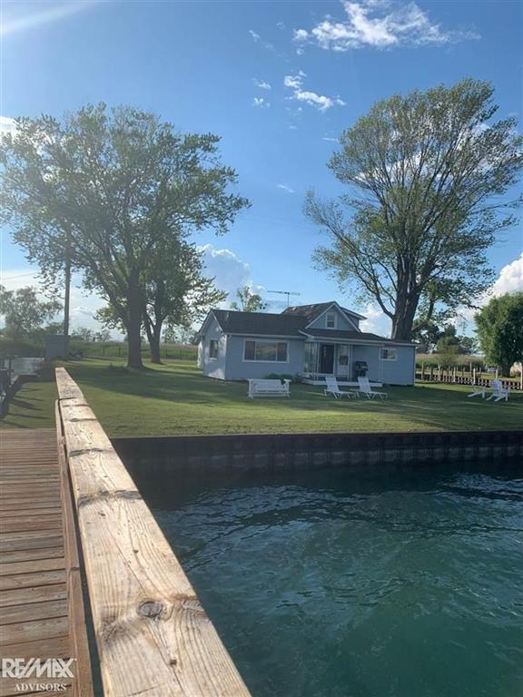 Beautiful Middle Channel [ remodeled in 2021] Cottage. In our highest water this property never flooded. 540 ft' steel seawall over 200k in wall!! Brand NEW Flooring, Fixtures & Furnishings! Newer Appliances. Additional Bunk-House/ Guest House for all your family & friends with kitchen and plumbed for a bathroom. Third house for laundry and storage could easily be another inlaw suite or kids bunkhouse! Large Shed in rear of property. This highly desired Middle Channel property only comes around once in a lifetime. 50 ft' Mini beach for swimming. Dock with Platform out to the Middle Channel to fish, relax, and enjoy all the waterfront has to offer. Underground Sprinklers. Gas Generator. Newer Septic. Newer windows and Electric 2017. Vinyl coated Pilings. Additional bedroom in the upstairs. Close to all the Bays and restaurants. BIG BOATS WELCOME and this cottage can accomodate them ALL! This cottage is a MUST SEE!! All you need to do is pack a suit-case as this cottage comes FURNISHED!!