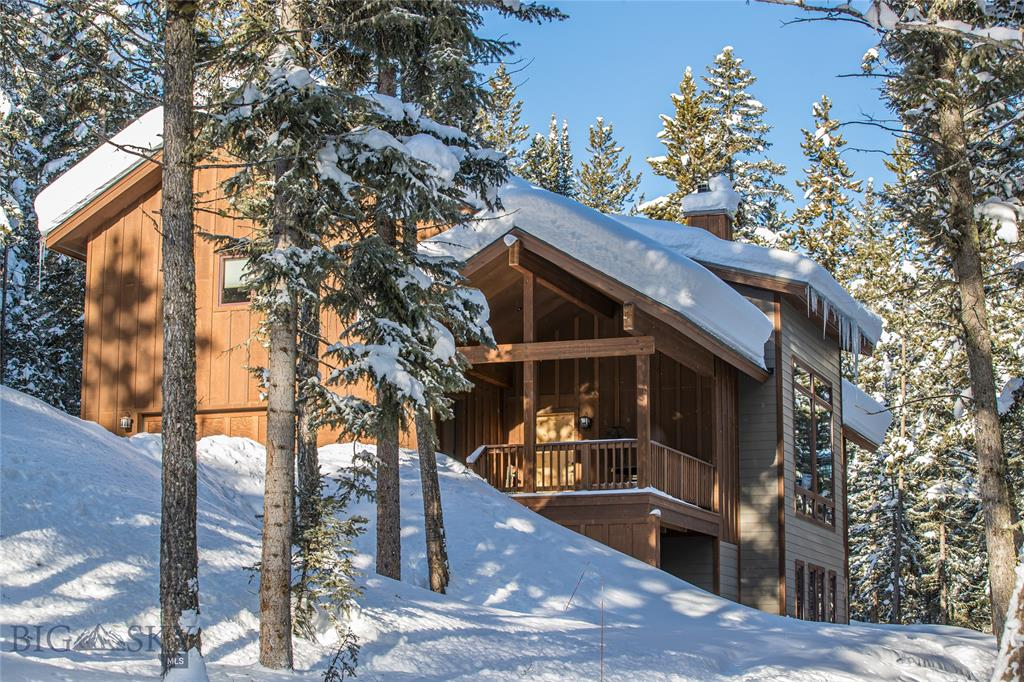 This beautiful custom home is nestled in the trees on a large, 4 acre, elevated lot which adds to the tranquility and peacefulness of the setting. The outdoor splendor envelopes you as the expansive windows and cathedral ceilings bring the outdoors in as you are nestled in the woods with over 70 acres of open space, the Middle Fork of the Gallatin River and the Spanish Peaks as your views.   Inside you will find a tasteful combination of walnut floors, wood detailing, granite counters and a stacked stone double sided fireplace.   The master suite opens up to the library and office which overlook the grand living room.   The additional family room is on the lower level as well as 2 bedrooms affording space for all.  The covenants allow for, and there is plenty of space for, a guest house on the property with proper approvals.   There are plenty of hiking, fishing, biking & cross country skiing opportunities for the entire family to enjoy just steps from the edge of the property.