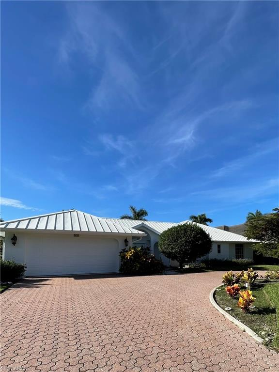 This Southern exposure  4 bedroom, 3 bath pool home has over 2,500 sq. ft. under air and 2,955 sq. ft. under roof with the lot size measuring 92x151. The home has a newer metal roof and an updated kitchen with marble countertops and a Viking gas range and Subzero fridge/freezer. The home has been professionally painted on both the interior and exterior. Located on Regatta Rd in the Moorings neighborhood just blocks to the Gulf of Mexico and white sand beaches with the opportunity to join the private Moorings Beach Park.
