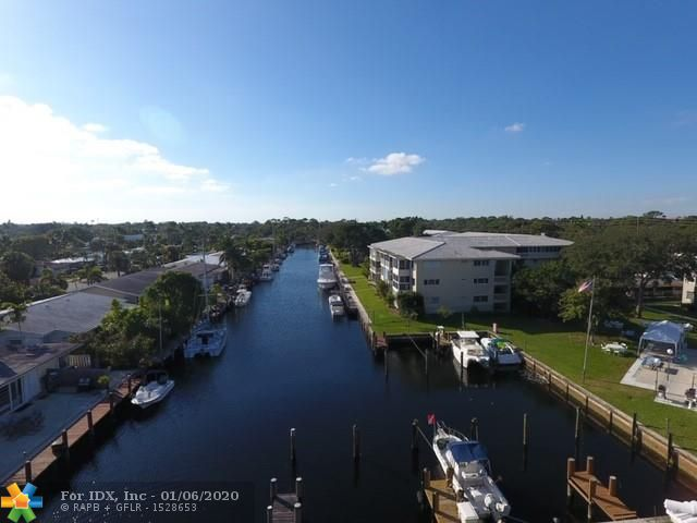 Gorgeous canal and pool view from this freshly updated 2/2 condo.  Deeded dock accommodates up to 35 foot boat with no fixed bridge access to intracoastal. Amenities include heated pool, clubroom and barbecue area.  Porch enclosed with impact windows for added square footage.  Your new home is conveniently located close to downtown, Las Olas, airport, shopping, restaurants, and all that fort lauderdale has to offer.  Pets under 20lbs.